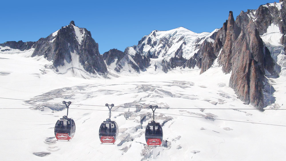 """Mount Blanc (4,810m) as seen from the cable cars """" flying over """" its glacier"""